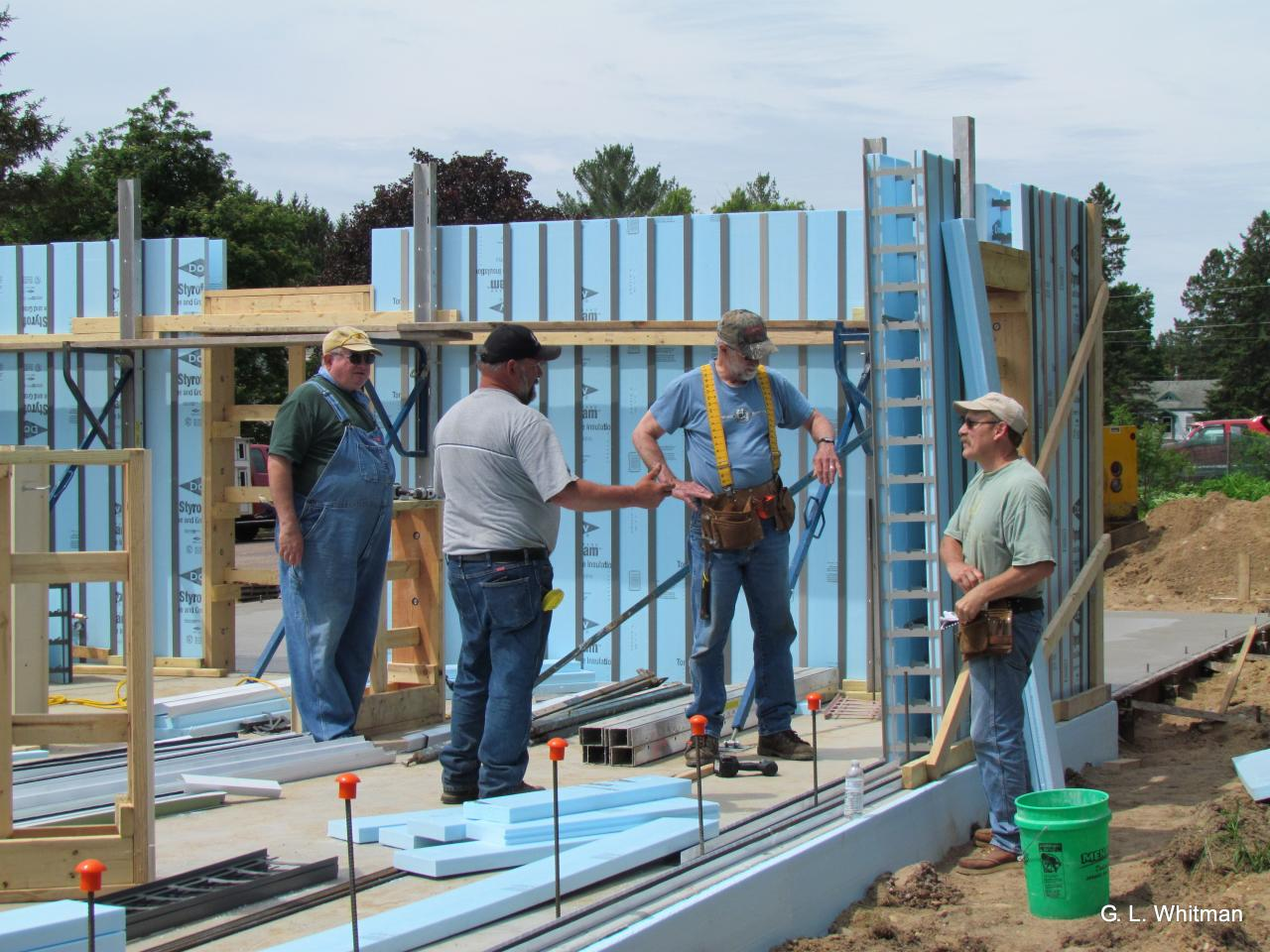 Photo of Volunteers Working on a House
