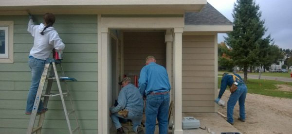 Photo of People doing home repairs